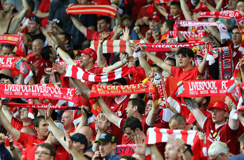 Liverpool Fans Waving Scarves